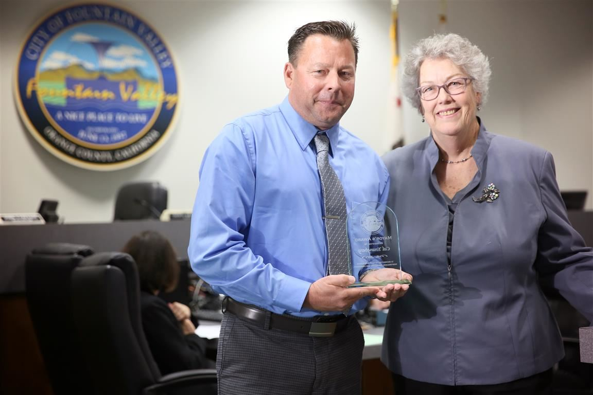 Cal Youngberg recieves the Mayor's Award from Mayor Cheryl Brothers