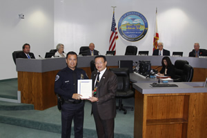 Mayor Vo and Officer of the Year Oscar Valencia